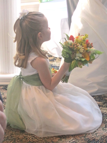 Hannah holds Christy's bouquet during the ceremony