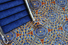 Gnarly carpet, man! (Wyoming_Jackrabbit) Tags: blue red abstract carpet colorful stair view bright mosaic circles navy steps staircase gaudy tacky overhead concentric skyblue