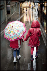 The Journey Of Sisters (Mark Emirali) Tags: street girls light newzealand portrait colour reflection art wet rain kids umbrella canon children mood auckland journey lane nz canon5d coats aotearoa handinhand copyrighted pleasedonotusewithoutmypermission maloe4 5dmkii maloephoto maloephotography markemirali markemiraliphotography