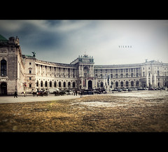 Hofburg Vienna [Explored] (Photofreaks) Tags: vienna wien old city travel winter shadow vacation two horse brown white snow black tourism wheel architecture vintage buildings season geotagged austria town sterreich team waiting europe driving tour carriage ride cab traditional wheels transport historic transportation imperial historical classical cart tradition danube chaise excursion austrian fiaker hofburg stefansplatz stefansdom donau heldenplatz droshky horsedriven photofreaks hockneycoah geo:lat=4820693620 geo:lon=1636418939 wwwphotofreakseu adengs explored20110430