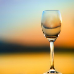 """Empty Wine Glass in Sunset"" (helmet13) Tags: d90 raw minimalist colors wineglass sunset reflection selectivefocus bokeh empty world100f 100faves studies gettyimages simplicity"