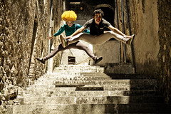 Clowns are jumping on the stairs! (missfranci11) Tags: clowns clown pagliacci portrait canon eos 7d yellow curly hair parrucca ricci giallo circus circo door paese porta ruins jump stairs crazy high speed shoot girl woman donna ragazza man boy