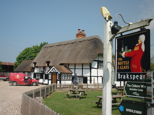 thatched pub and post van
