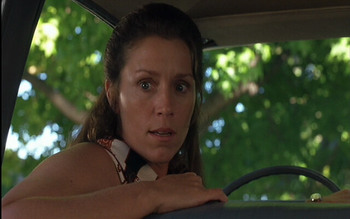 this is a photo of Frances MdDormand as Elaine Miller, swiveling around in the front seat of her car to talk with her children in the back seat