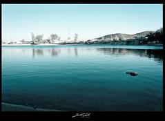 Serenity (Zhenwu86) Tags: arizona lake mountains water rock still nikon tucson ripple shore serenity kennedylake aspiring d90 coldtone