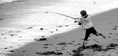 Young Man Fishing (Jolyon Yates) Tags: boy sea fish beach coast seaside fishing surf boots leg north cast lad fisher rod balance poise whitleybay