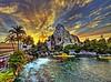 Sunset over Tomorrow...[Explore #42] (Ring of Fire Hot Sauce 1) Tags: sunset sky water disneyland matterhorn tomorrowland goldenhour findingnemosubmarine findingnemolagoon