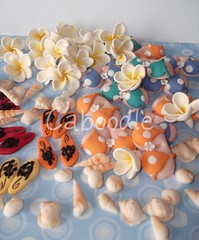 lifes a beach (The Whole Cake and Caboodle ( lisa )) Tags: newzealand shells beach island cupcakes boobs bust cupcake bikini thongs handpainted flipflops frangipani 50th toppers whangarei caboodle polkadotbikini frangipanis jandles thewholecakeandcaboodle