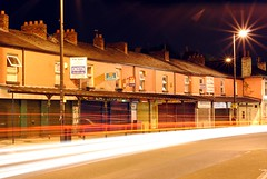 Stockport Road at night 10 - Shop swoosh! (zawtowers) Tags: road light night facade manchester lights long exposure shot victorian trails stockport a6 swoosh m19 twinkly levenshulme afsnikkor50mmf18g