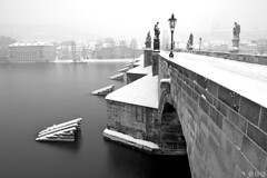 The Charles Bridge in winter morning / Karlv most v zimnm rnu (Jirka Chomat) Tags: city morning bridge bw white black tower castle creek river czech prague prag charles praha praga praskhrad most czechrepublic lampa wintersnow charlesbridge zima bohemia vltava hrad praguecastle karlvmost msto eka socha snh svtn rno ernobl pil mstskv ledolamy