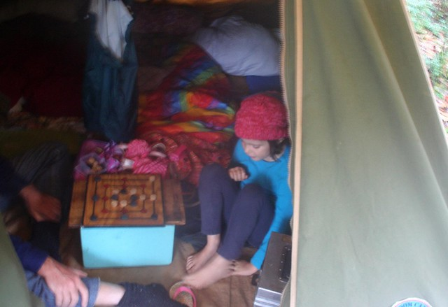 g and g playing draughts in the tent