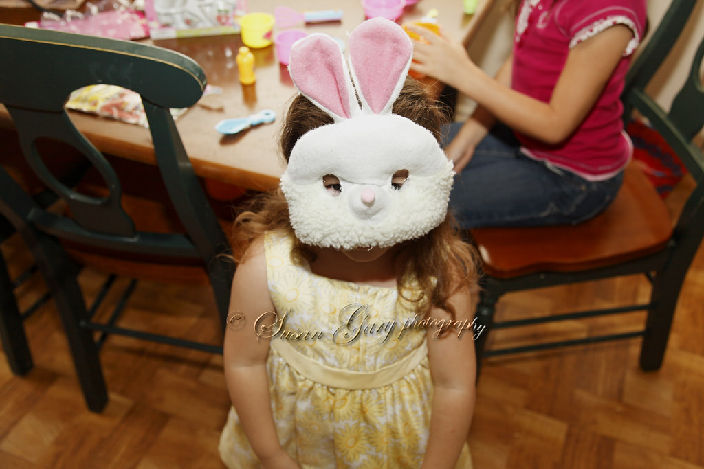 Toddler Girl in Bunny Mask Looking Up