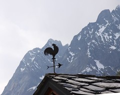 Face au mauvais temps qui s'installe (Larch) Tags: roof italy cloud mountain alps montagne alpes grey gris italia cock nuage toit italie coq windvane weathercock girouette aiguille valferret valdaoste peuterey concordians aiguillenoiredepeuterey mygearandme