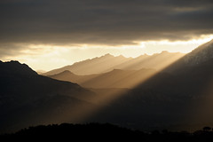 Backlight Mountain Sunrise, from Calvi, Corsica, France (Xindaan) Tags: morning winter light sky orange cloud sunlight white mountain plant black france mountains tree nature colors berg yellow rock backlight clouds sunrise landscape geotagged outdoors dawn licht flora nikon scenery europa europe cloudy corse calvi natur corsica pflanze himmel wolke wolken sigma overcast nopeople berge granite dmmerung landschaft stein sonnenaufgang morgen 70200 baum schwarz scenics d3 backlighting gegenlicht gebirge 70200mm wolkig mountainrange telezoom korsika granit weis 2011 sonnenlicht 7020028 beautyinnature sigma70200f28exdghsm nonurbanscene d3s lavaccaja
