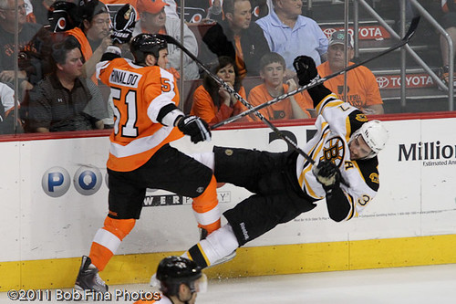 Zac Rinaldo #51of the Philadelphia Flyers knocks down Patrice Bergeron #37 of the Boston Bruins on April 30, 2011 at the Wells Fargo Center in Philadelphia, PA. The Bruins defeated the Flyers 7-3. The