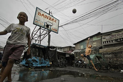 Aroma compound, Tondo, Manila - Basketball game after the storm (Mio Cade) Tags: poverty boy storm game basketball court children fun compound kid child play joy poor social housing esther typhoon reportage aroma