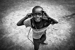 The photographer   - DR CONGO - (C.Stramba-Badiali) Tags: africa street portrait blackandwhite smile face look contrast rural pose children person eyes photographer village emotion noiretblanc expression african joy human remote shavedhead ethnic enfant glance humanbeing complicity humanitarian oneperson drc visage regard afrique zaire rdc drcongo blackchildren blackskin centralafrica ethno africanchildren gety ethnie musungu congokinshasa ituri peaunoire afriquecentrale lendu 5dmkii tterase forgottenconflict christophestrambabadiali