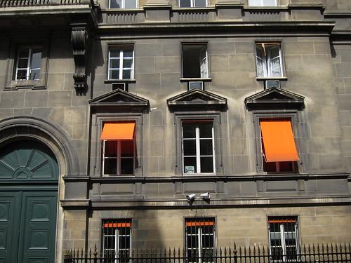 Orange window awnings