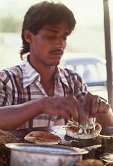 'Bun Kababs' (Batool Nasir) Tags: world street pakistan portrait woman man work jobs editorial worker vendor karachi allrightsreserved peopleatwork streetvendors filmphotography 35mmfilmformat batoolnasir bunkababs