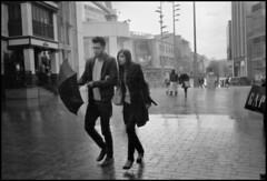 Rainy Sunday (*monz*) Tags: street leica blackandwhite bw streets film wet rain zeiss umbrella 35mm birmingham couple pavement iso400 candid gap 150 rainy carl pro cz rodinal legacy m6 brum 20c biogon f20 monz autaut