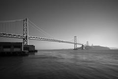 Tilted Bridge (Joe Azure) Tags: sf sanfrancisco california ca morning bridge blackandwhite bw water monochrome sunrise bay azure baybridge tilt tse24