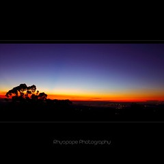 An Autumnal Sunrise (rhyspope) Tags: longexposure morning blue sunset red sky orange white mist black color colour silhouette yellow fog sunrise canon lights view bright australia lookout gradient aussie hawkesbury kurrajong 500d rhyspope