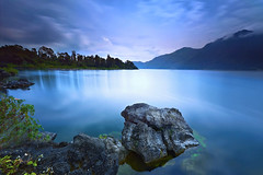 Morning Blues (tropicaLiving - Jessy Eykendorp) Tags: longexposure blue light sky bali lake motion green beach nature water rock clouds canon reflections indonesia landscape island photography eos volcano asia southeastasia outdoor mount crater caldera lee nd land filters 1022mm active batur kintamani canon1022mm gnd 50d bigstopper lee10stopnd