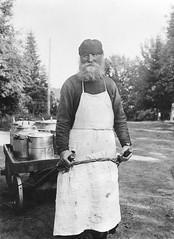 Priest, Valamo Monastery, Karelia, Russia (Swedish National Heritage Board) Tags: man standing beard outdoors thirties 1930s apron monastery older buckets priest cans cart karelia barrow riksantikvariembetet theswedishnationalheritageboard