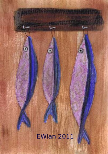 three little fishes hanging in a row 7