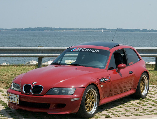 Imola Red Supercharged M Coupe with Gold Fiske FM-10 Wheels