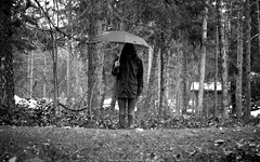 I see the world in black & white. (Michael Overbeck | www.michaeloverbeck.com) Tags: trees portrait white snow canada black forest umbrella self canon whistler photography michael hoodie tripod shed columbia jeans british f18 50 timer bushes centered | overbeck 60d