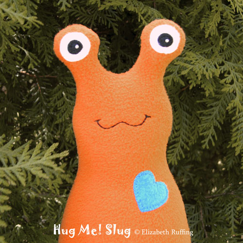 Orange Fleece Hug Me Slug by Elizabeth Ruffing