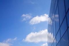 Copenhagen airport (hartvigs) Tags: wallpaper sky reflection clouds copenhagen 50mm f14 bluesky 5d canon5d usm copenhagenairport 50mmf14 canon50mm glaswall kaustrup