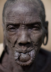 Old Surma woman without lip plate - Omo valley Ethiopia (Eric Lafforgue) Tags: africa de la artistic des east ornament clay elder l bodypainting ethiopia rite ages bodymodification labret adornment pigments nomade omo eastafrica vallee 1326 levre estvillage nomadicpeople humainhuman tulgit peoplesuri tribetribu surisuri peoplesoftheomovalley piercedhole piercedlipornament labiallabretstretched liplevre etireelevre perceepierced lipornement perceesurmasuritributribetribu tribesurma surmasurma peoplepeuple suripeuple surmaargilefemme plateauplateaucontemplationtraditional clotheshabit traditionnelpeuples omopeoples valleypeuple objectiflooking turgitvillage cameraabyssinieafrique africahorizontalverticalcolored picturecoloured picturecolourphoto couleuretre beingpersonpersonnepeoplefemalefemmewomandehorsoutsideoutdoorsvue exterieureexterieurfacevisageteteportaitheadshotregardant turgitturgitplateau