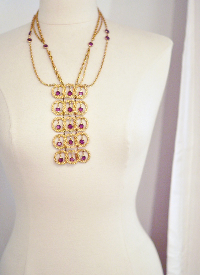 70's circle gold pendant necklace on mannequin