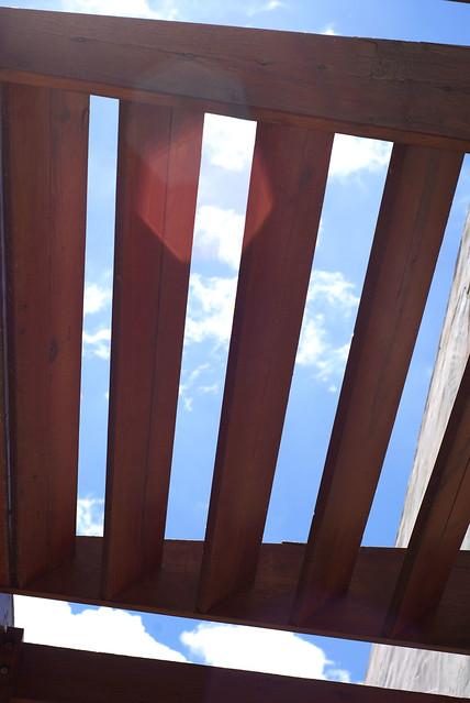 Sky through wood