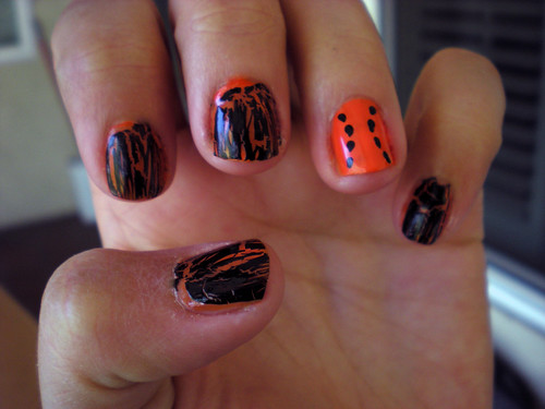 black and orange baseball mani