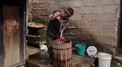 Video Still: Gregorio churns ice cream in a wooden barrel.
