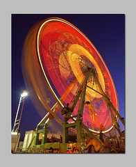 Wonder Wheel! (RZ68) Tags: carnival blue light red sky orange motion blur film wheel yellow night lights evening big crazy colorful long exposure ride dusk spin fair ferris barf velvia hour spinning huge ferriswheel rides midway provia puke e100 rz68