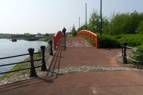 Belfast City - A Walk Along The River Lagan (American tourist on bridge)