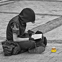 Lost in a good book (NRG Photos) Tags: germany buch deutschland book reader candid homeless beggar panhandler mnster selectivecolour schnappschuss bettler obdachlos leser selektivefarbe