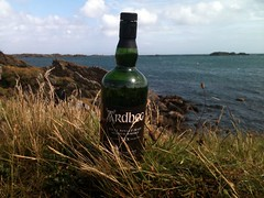 Ardbeg bottle enjoying the view from Ardbeg distillery