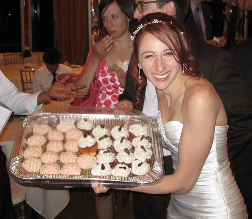bride and tray of cupcakes