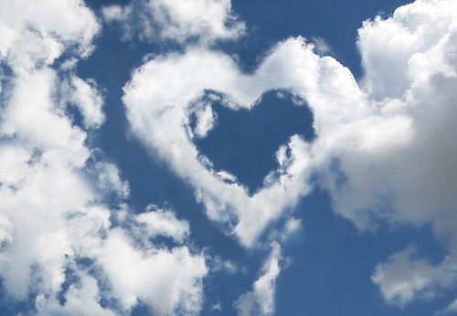 Clouds against a blue sky forming a heart