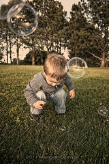 Lil' Man vs. Bubbles (Didenze) Tags: park portrait toddler raw child bubbles danapoint tone goldenhour nikolas 22months canon450d didenze
