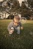 Lil' Man vs. Bubbles (Didenze) Tags: park portrait toddler raw child bubbles danapoint tone goldenhour nikolas 22months canon450d didenze
