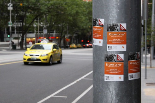 Pole covered in South Pacific Health Clubs advertising