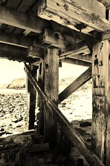 Second Valley #13 (robynbrody) Tags: ocean bridge sea blackandwhite beach water rock sepia geotagged bay pier sand rocks jetty australia historic wharf southaustralia secondvalley gulfstvincent saintvincentgulf