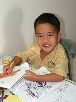 Julian at his workbooks