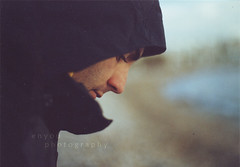 by the sea (e n y o u) Tags: sea portrait man film beach 35mm bokeh hood northface  canont70 mimancalamiacanont70